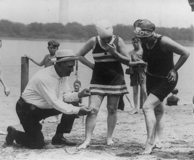 policeman-measuring-bathing-suit